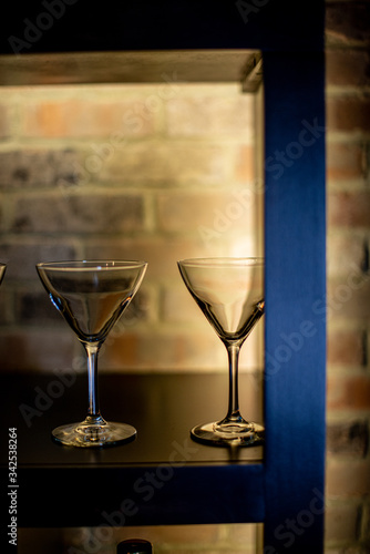 Photo Martini glasses on backlight shelf