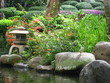 Lovely Japanese lantern in the garden with flowers