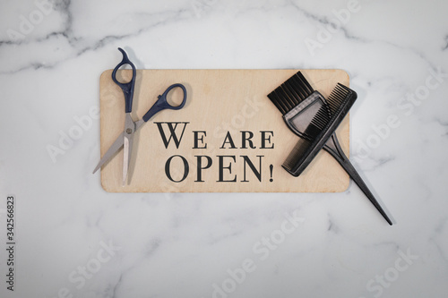 Photo Hair salon we are open sign no people flat lay background with scissors black sm