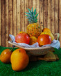 fruits in handmade basket with wooden background
