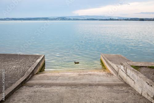 Boat ramp at Lake in Zuc, Switzerland Fotobehang