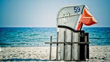 Hooded Beach Chair Against Clear Sky