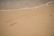 High Angle View Of I Miss You Text At Beach