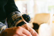 Cropped Hand Of Fashion Designer With Pin Cushion