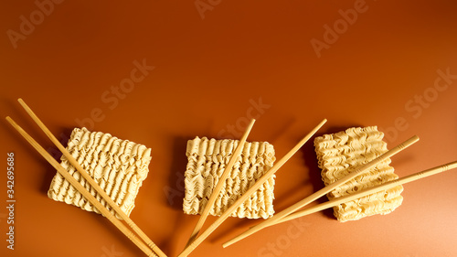 Fényképezés Raw dried instant noodles with chopsticks with copy space
