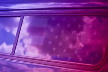 Reflection Of American Flag On Car Window