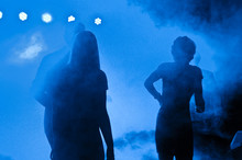 People Amidst Smoke In Party At Night