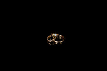 Close-up Of Wedding Rings On Black Background