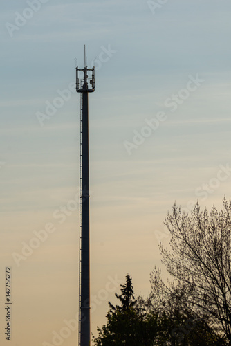 Telecommunication tower with cellular network antenna against blue sky as backgr Canvas Print