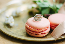 Wedding Rings On A Macaroon Cakes As Decoration