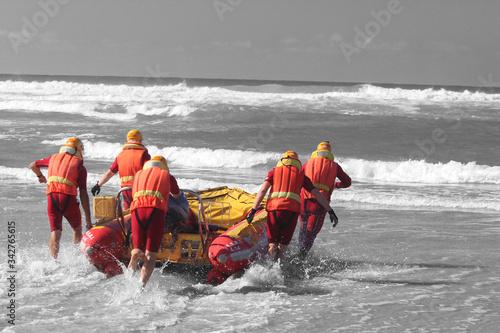 Fototapeta rescue crew launching inflatable boat