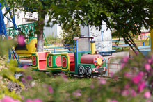 Outdoor Play Center For Children With Train And Railway Attrations. Entertainment Concept.