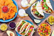 Table With Tacos, Mango Salsa,...