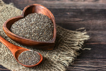 Chia Seeds In A Wooden Bowl An...