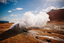 Geyser In Hverir, A Geothermal Area Known For Its Bubbling Pools Of Mud & Steaming Fumaroles Emitting Sulfuric Gas, Namafjall, Iceland