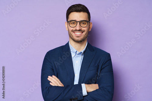 Vászonkép Business male isolated on purple background, feeling energetic and confident, sm