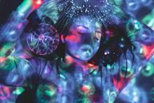 Digital Composite Image Of Woman And Plasma Ball With Fiber Optics