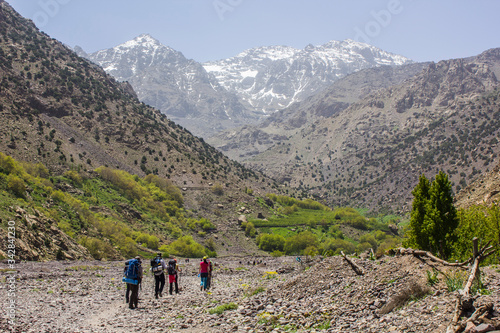 Mountaineers caravan hiking over a huge valley of the great atlas of morocco wit Wallpaper Mural