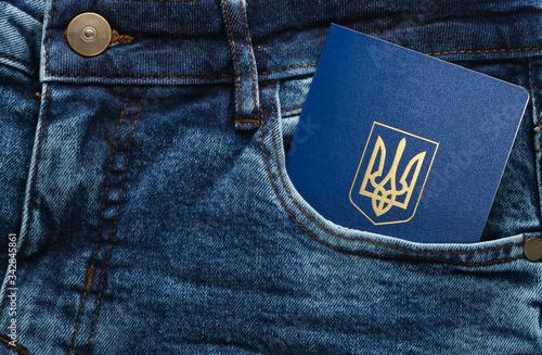 Vászonkép Ukrainian passport in front pocket of blue jeans