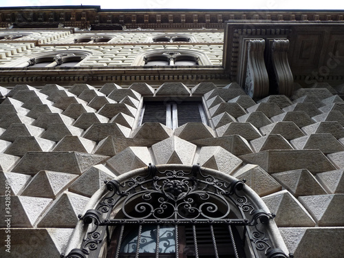 Detail of wall with pyramidal ashlars of an historic building in the city of Milan Canvas Print