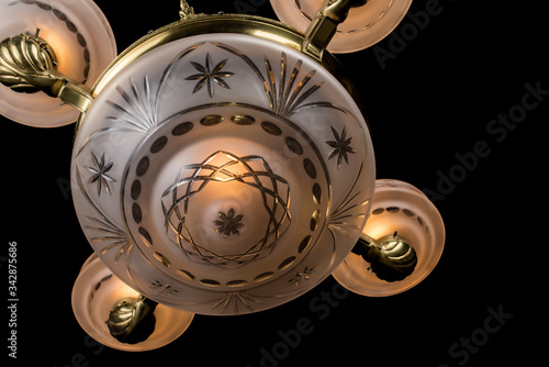 Photo vintage chandelier on black background, bronze antique chandelier with burning l
