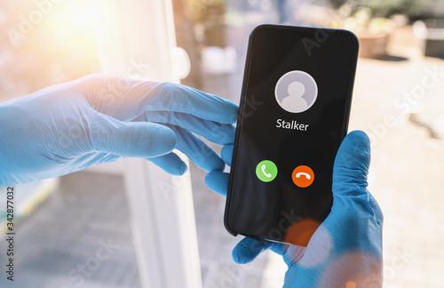 Phone call from a stalker at during coronavirus epidemic Obraz na płótnie