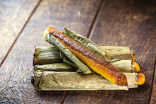 Broa Made With Corn And Wrapped In Banana Leaf. Typical Brazilian Dessert Called Bread-a-pique Bread, Brazilian Bread Or Corn Bread.