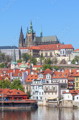 Fototapety, obrazy: Stunning skyline of Prague, Czech Republic with dominant Prague Castle. The historical center of the Czech capital is located along river Vltava. Sunny day, clear sky. Beautiful Czechia