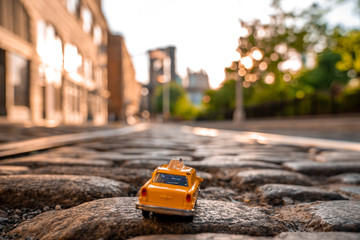 Classical taxi model car parked on an old street in Brooklyn near Brooklyn bridge.
