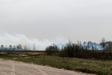 Smoke From A Fire In A Field