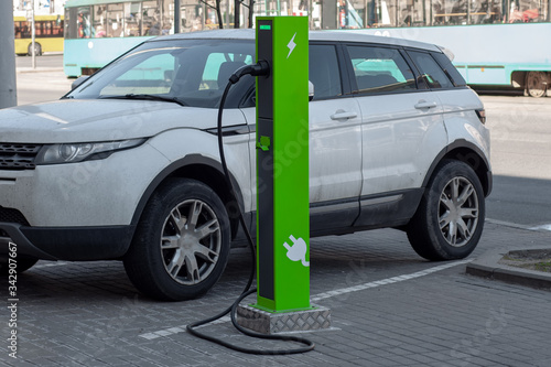 Leinwand Poster Power supply for electric car charging