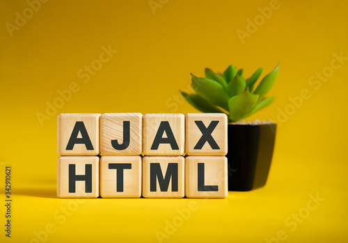 Photo AJAX HTML - text on wooden cubes, green plant in black pot on a yellow backgroun