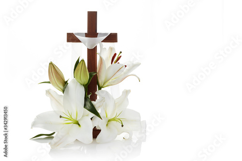 Obraz na plátně Cross with lilies isolated on white background for decorative design