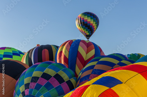 A pillow top of hot air balloons gets ready to go in the early morning at the ma Canvas Print
