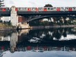 Train Passing Over An Arch Bridge