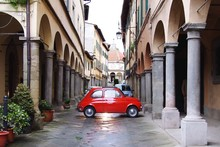 Red Beetle Car In Narrow Street