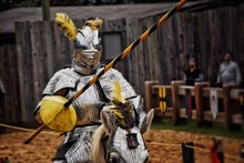 Knight In Armor Riding Horse