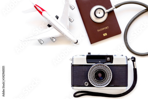 Fényképezés Mockup image of medical stethoscope, passport book, airplane model, camera isolated on white background