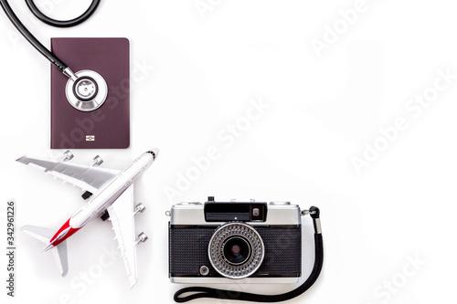 Vászonkép Mockup image of medical stethoscope, passport book, airplane model, camera isolated on white background