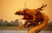 Chinese Dragon By Lake During Sunset