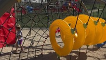 SAN JOSE DEL CABO MEXICO-2019: Young Girl Ducks Under Net In A Childrens Playground