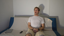Shocked Young Man Sitting On C...