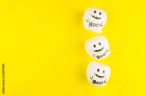 Fényképezés Boo cute ghost toy isolated on yellow background
