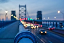 Illuminated Vehicles On Benjamin Franklin Bridge Against Sky During Sunset