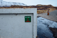 Information Sign On Wall Against Mountains During Winter