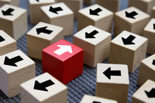 Cube Wooden Toy Blocks With Arrow Opposite Each Other. Concepts Of Organizational Change To Bussiness Adapting.