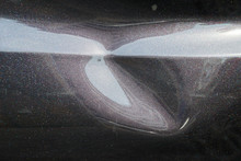 A Black Car Body Dent Needs A Repair