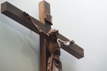 Low Angle View Of Jesus Christ Statue By Wall