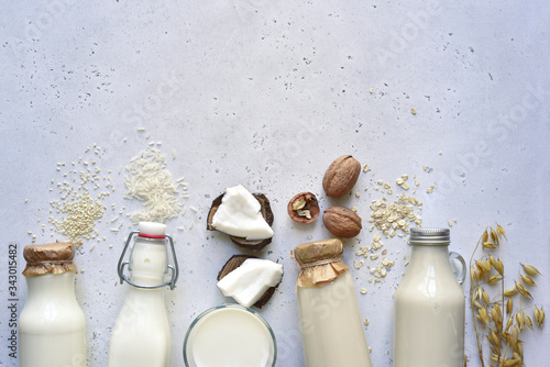Papel de parede Alternative types of vegan milks in glass bottles