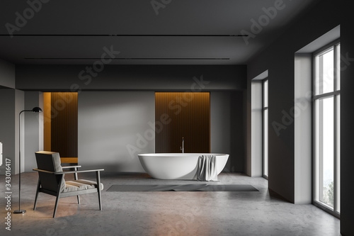 Photo Dark gray bathroom, tub and armchair